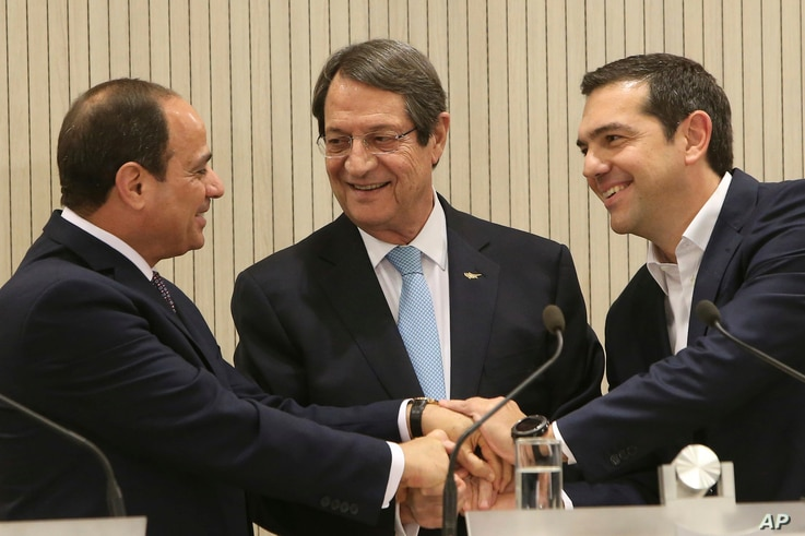 FILE - Cyprus President Nicos Anastasiades (C) Greek Prime minister Alexis Tsipras (R) and Egypt's President Abdel-Fattah el-Sissi, shake hands after their meeting at the presidential palace in capital Nicosia, Cyprus, on Nov. 21, 2017.