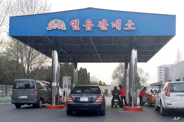 FILE - Cars line up at at a gas station in Pyongyang, North Korea, April 1, 2016. North Korea has been condemned and sanctioned for its nuclear ambitions, yet has still received food, fuel and other aid from its neighbors and adversaries for decades....