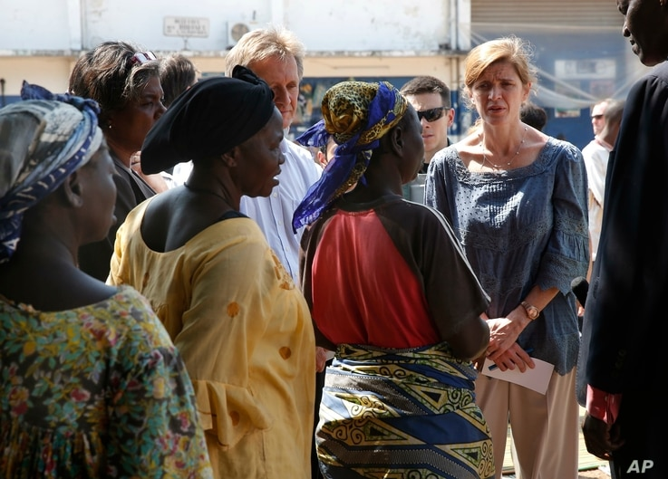 U.S. Ambassador to the United Nations Samantha Power speaks to IDP women at the makeshift camp where over 40,000 found refuge at the airport in Bangui, Central African Republic, Dec. 19, 2013.