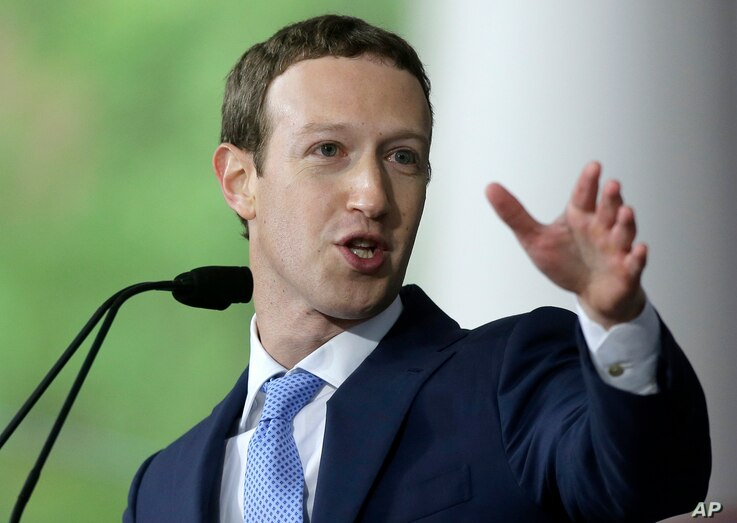 Facebook CEO and Harvard dropout Mark Zuckerberg delivers the commencement address at Harvard University, May 25, 2017, in Cambridge, Mass. On Tuesday, Zuckerberg praised Lola Omolola Tuesday for her Female IN Facebook page.