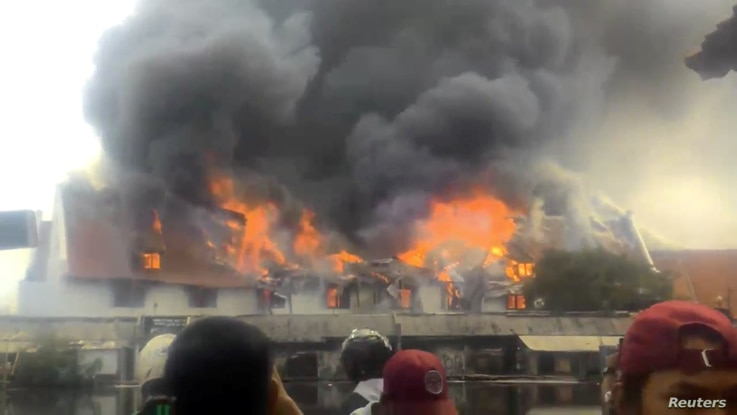 Smoke rises from a fire at the Maritime Museum in Jakarta, January, 16, 2018, in this still image taken from a social media video.
