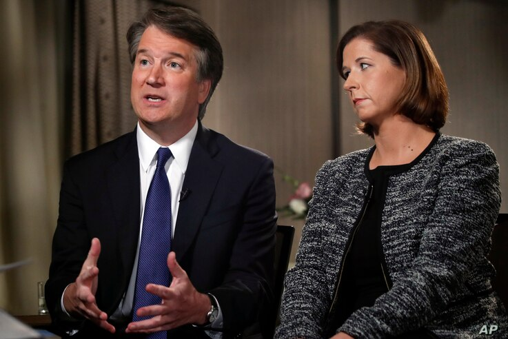 Brett Kavanaugh, with his wife Ashley Estes Kavanaugh, answers questions during a FOX News interview, Sept. 24, 2018, in Washington, about allegations of sexual misconduct against the Supreme Court nominee.