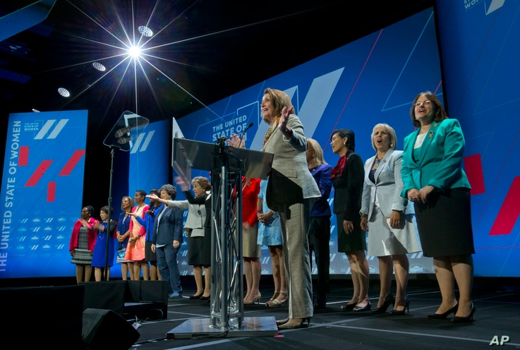 FILE - House Minority Leader Nancy Pelosi of Calif, center, is joined on stage with other woman members of Congress, as she addresses the White House Summit on the United State of Women in Washinton, June 14, 2016.