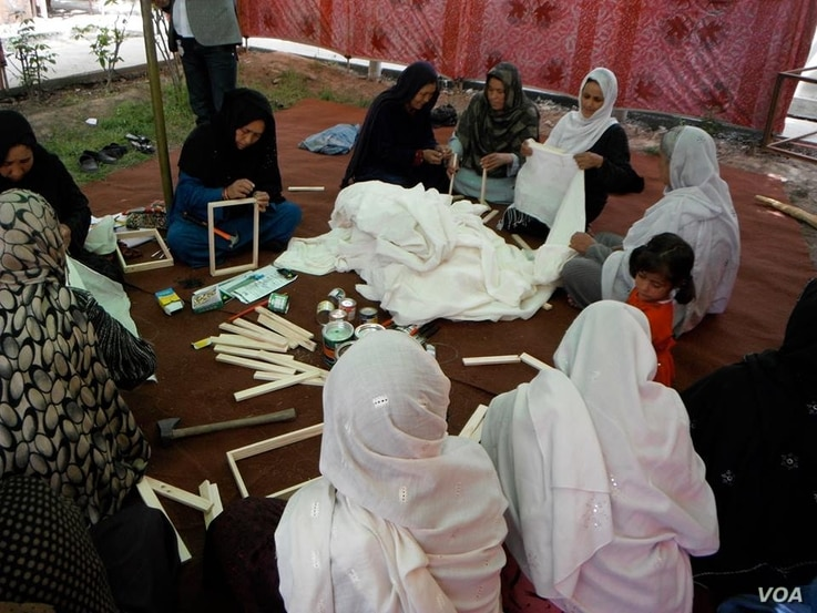 Member of the Memory Box Initiative are preparing frames for the project in Kabul, Afghanistan. (Photo: Afghanistan Human Rights and Democracy Organization)