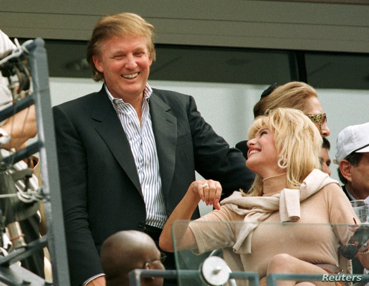 FILE - Developer Donald Trump talks with his former wife Ivana Trump during the men's final at the U.S. Open.
