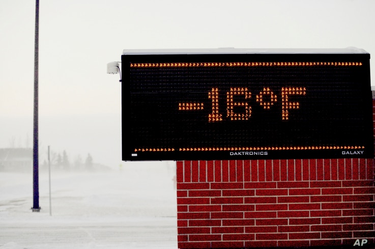 A Moorhead, Minnesota elementary school electronic sign shows to temperature, Jan. 29, 2019. Daytime temperatures in the Fargo ND-Moorhead MN area were near -20F as frigid weather grips the area.