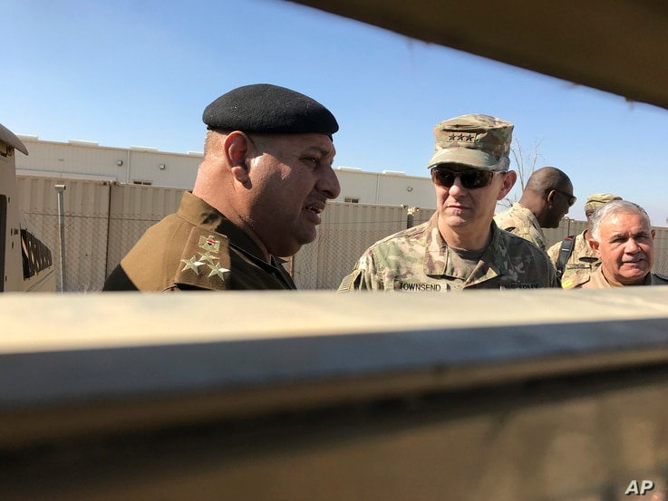 FILE - U.S. Army Lt. Gen. Stephen Townsend, center, speaks with an Iraqi officer during a tour north of Baghdad, Iraq, Feb. 8, 2017. Senior U.S. commanders say Iraqi forces are largely ready for their next major campaign against Islamic State extremi...