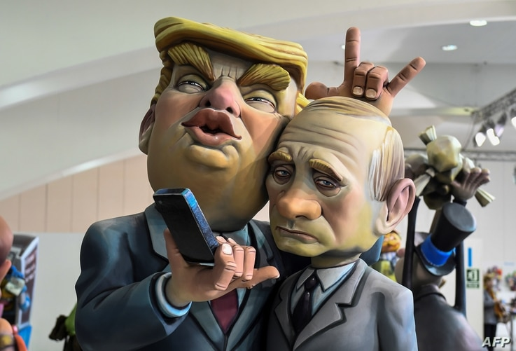 A Ninot, a doll depicting a celebrity that will be set alight during the Fallas festival, representing U.S. President Donald Trump and Russian President Vladimir Putin is displayed in Valencia on March 09, 2018.