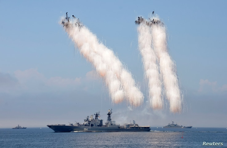 Russian warships sail past exploding anti-missile ordnance during a rehearsal for the Navy Day parade in the far eastern port of Vladivostok, Russia, July 30, 2016.