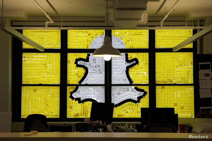 FILE - An image of the Snapchat logo created with Post-it notes is seen in lower Manhattan, New York, May 18, 2016.