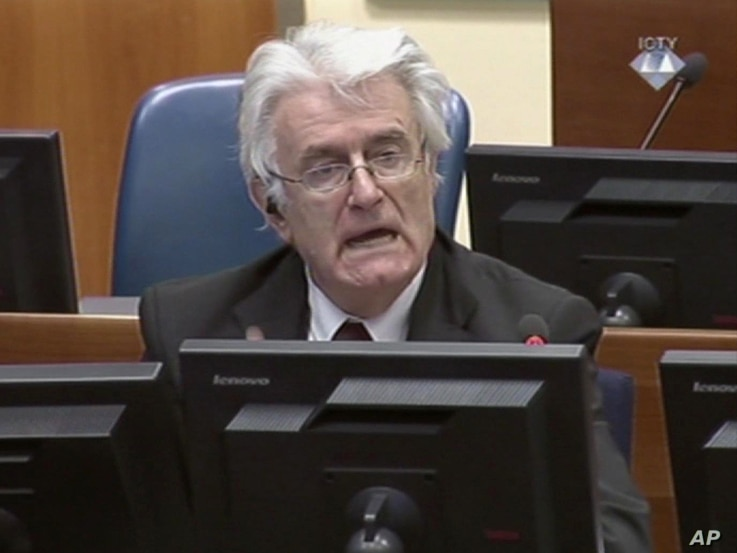 FILE - Former Bosnian Serb leader Radovan Karadzic addresses the court of the International Criminal Tribunal for the former Yugoslavia in The Hague, Netherlands, in this image taken from TV, Oct. 1, 2014.