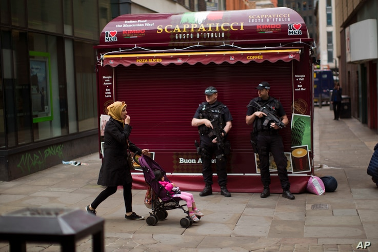Police officers stand guard in central Manchester, Britain, May 24, 2017 after Monday's suicide attack at an Ariana Grande concert.