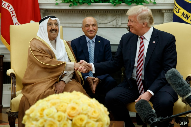 President Donald Trump shakes hands with Amir of Kuwait Sheikh Sabah Al Ahmad Al Saba during a meeting in the Oval Office of the White House, Sept. 7, 2017, in Washington.
