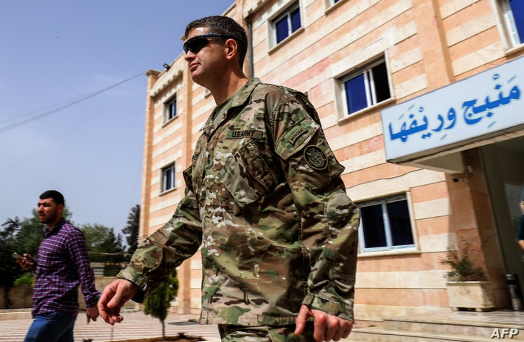U.S. Army Maj. Gen. James B. Jarrard leaves after a meeting in the YPG-held northern Syrian city of Manbij, where the U.S. has a military presence, March 22, 2018.