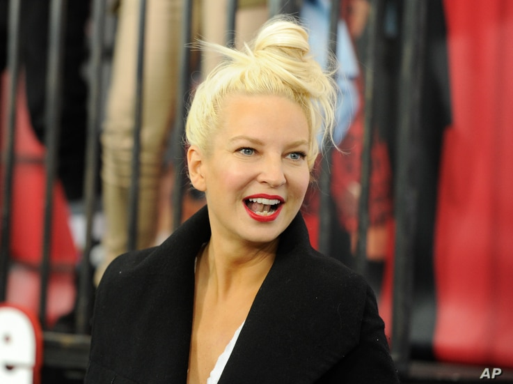 "FILE - Singer Sia Furler attends the world premiere of ""Annie"" at the Ziegfeld Theatre in New York."