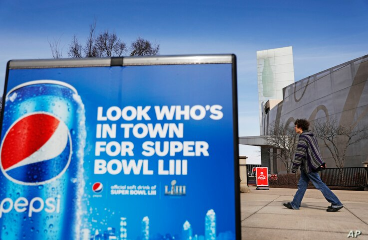A Pepsi advertisement stands outside the World of Coca-Cola museum in Atlanta, Jan. 30, 2019. The Patriots and the Rams aren't the only ones battling for Super Bowl supremacy this week. Pepsi and Coke also seem to be squaring off. Pepsi, an official ...