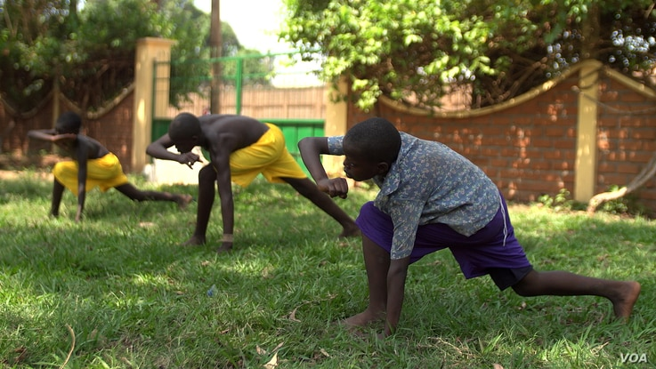 Two young orphans practice capoeira on the grounds of their orphanage. The martial art was developed centuries ago by African slaves in Brazil, April 20, 2017. (Photo: Z. Baddorf/VOA)