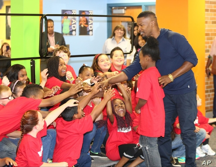 FILE - Actor Jamie Foxx at a Turnaround Arts event in Minneapolis, Sept. 10, 2014.