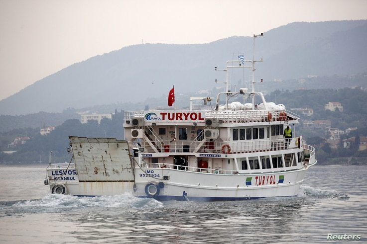 A Turkish-flagged passenger boat carrying migrants to be returned to Turkey leaves the port of Mytilene on the Greek island of Lesbos, April 8, 2016.