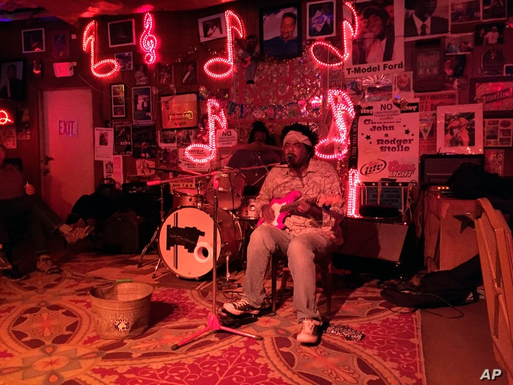 Guitarist Lucious Spiller performs at Red's, one of several clubs in Clarksdale, Miss., hosting live music, March 10, 2017.