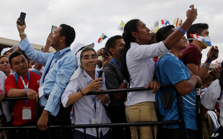 People take pictures as Pope Francis arrives at Tocumen international airport in Panama City, Jan. 23, 2019.