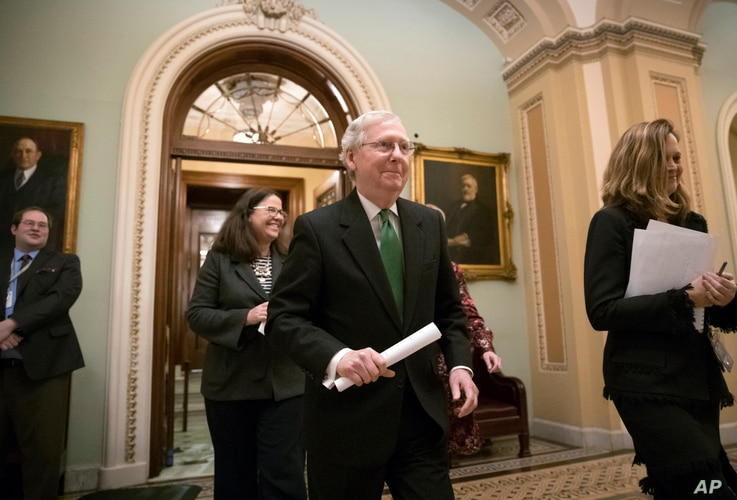 Senate Majority Leader Mitch McConnell, R-Ky., leaves the chamber after announcing an agreement in the Senate on a two-year, almost $400 billion budget deal, at the Capitol in Washington, Feb. 7, 2018.