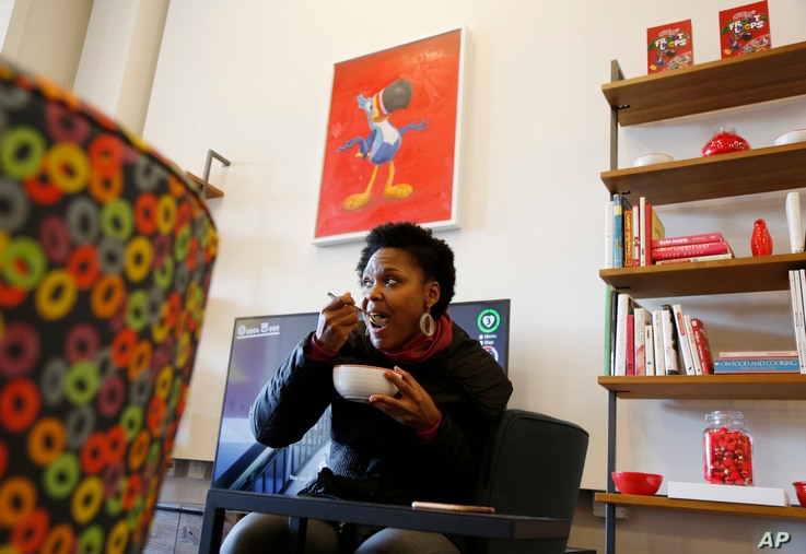 Shanelle Gabriel eats a bowl of cereal at Kellogg's NYC Cafe in New York, Dec. 14, 2017.