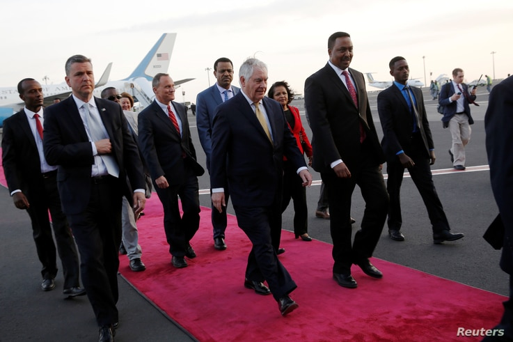 Ethiopia's Minister of Foreign Affairs Workneh Gebeyehu (center R) walks the red carpet with U.S. Secretary of State Rex Tillerson as he arrives to begin a six-day trip in Africa, landing at Addis Ababa International Airport in Addis Ababa, March 7, ...