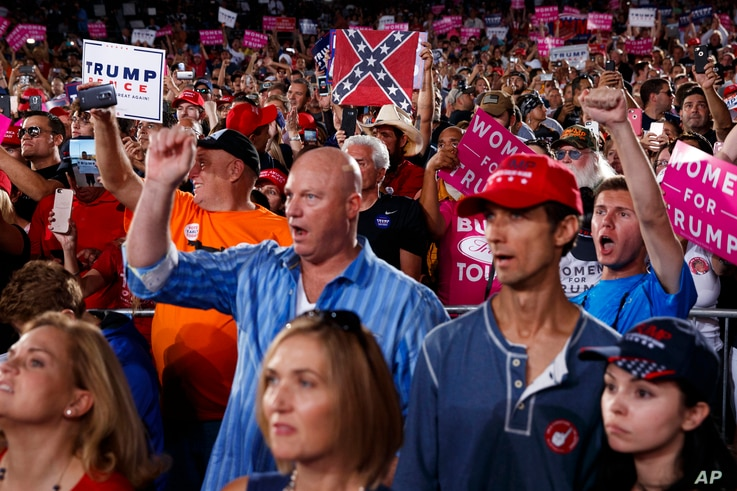 Supporters of Republican presidential candidate Donald Trump cheer during a campaign rally, Oct. 24, 2016, in Tampa, Fla.