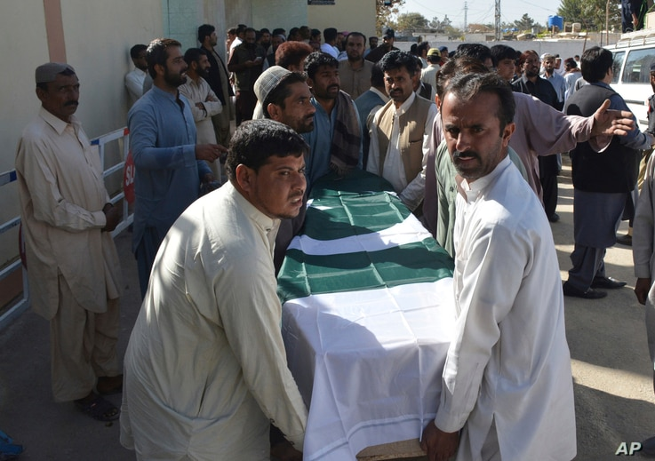 People carry the coffin of a victim of an overnight attack on a police academy, in Quetta, Pakistan, Oct. 25, 2016.