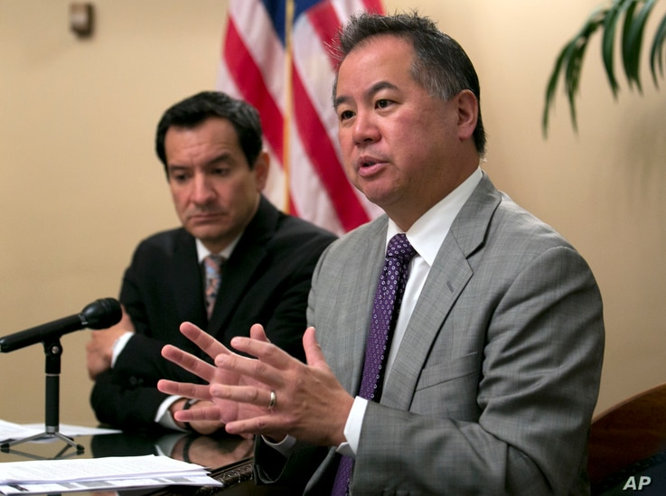 FILE - California Assemblyman Phil Ting, D-San Francisco, right, discusses the state budget in Sacramento, June 13, 2017. In 2016, Gov. Jerry Brown vetoed a bill by Ting that would have expanded the list of those who can seek gun violence restraining...
