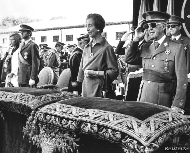 Former Spanish dictator General Francisco Franco salutes beside his wife Carmen Polo, the then Prince Juan Carlos of Spain and his wife Princess Sofia as they listen to the national anthem during a ceremony at El Pardo Palace, Oct. 4, 1975.
