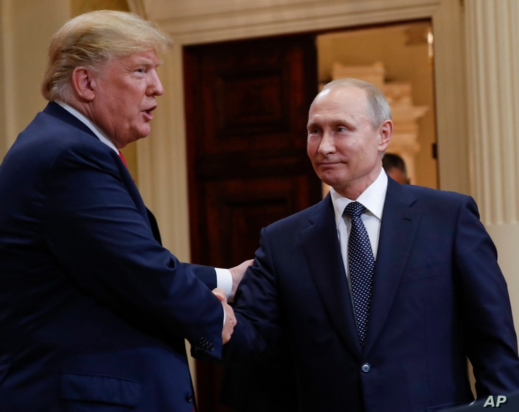U.S. President Donald Trump, left, and Russian President Vladimir Putin, right, shake hands at the conclusion of their joint news conference at the Presidential Palace in Helsinki, Finland, July 16, 2018.
