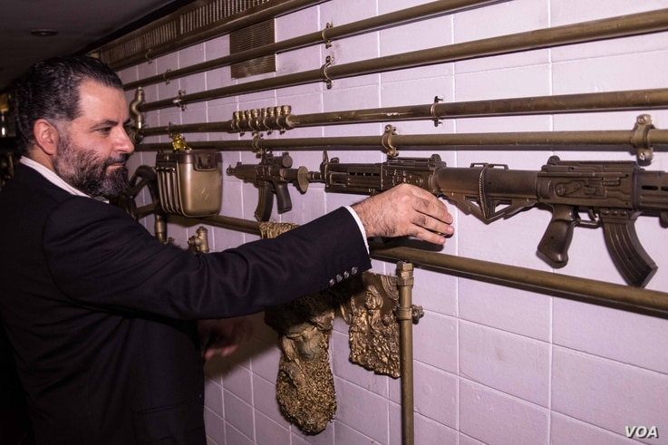 Michel Elefteraides' decor incorporates elements of violence - here guns are form part of the tubing on the walls of Nowheristan's headquarters, Beirut, Sept. 5, 2016. (Photo: J. Owens/VOA)