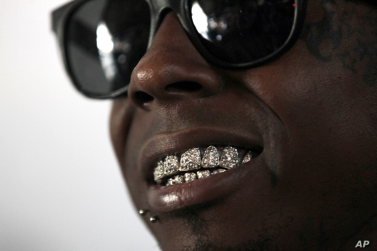 Recording artist Lil Wayne talks during an interview at the opening of a new skateboard park he helped finance along with Glu Agency and Mountain Dew, in the Lower Ninth Ward of New Orleans, Sept. 26, 2012.