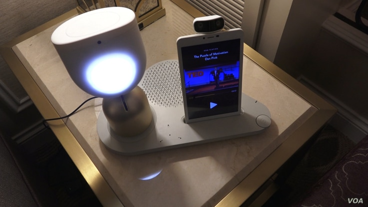 ElliQ, a companion for the elderly made by the Israeli company, Intuition Robotics.She initiates conversation with her user and motivates the user to stay connected with loved ones and active physically and mentally.