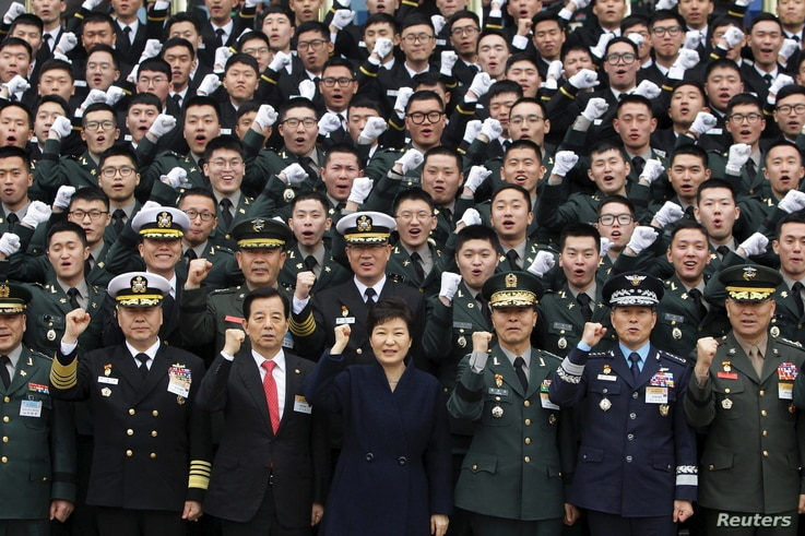 South Korean President Park Geun-Hye cheers with new military officers during a military commissioning ceremony at Gyeryongdae, South Korea's main military compound, March 4, 2016