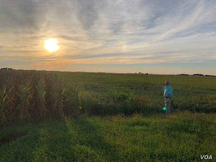Keith Puntenney, a plaintiff in a case against the Iowa Utilities Board, points to where the Dakota Access Pipeline was installed on his property about an hour from the state's capital, Sept. 7, 2018. He says permission was illegally granted for the ...