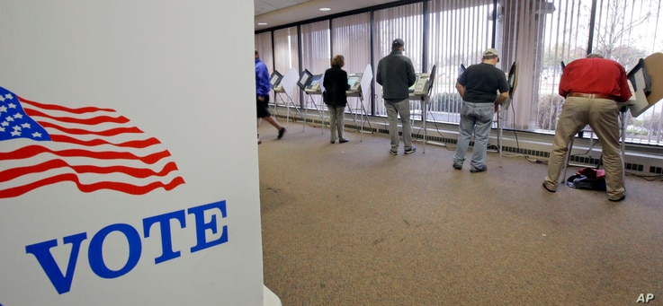 People vote during early voting for the 2016 General Election at the Salt Lake County Government Center on Nov. 1, 2016, in Salt Lake City.
