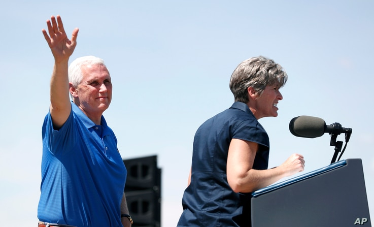 Vice President Mike Pence waves to supporters as U.S. Sen. Joni Ernst, R-Iowa, speaks during her annual fundraiser, June 3, 2017, in Boone, Iowa.