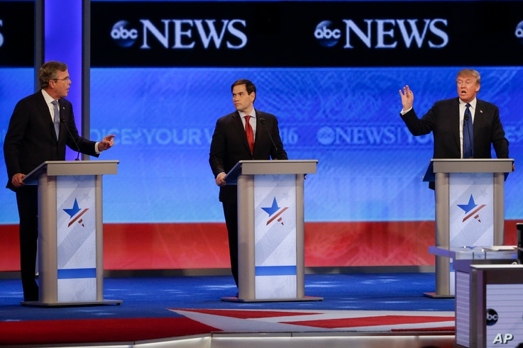 Candidates Jeb Bush, left, and Donald Trump, right, spar as Sen. Marco Rubio listens in the middle during a Republican presidential debate at St. Anselm College, Feb. 6, 2016, in Manchester, N.H.