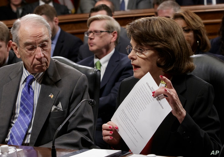 Senate Judiciary Committee Chairman Sen. Charles Grassley, R-Iowa, listens as the committee's ranking member Sen. Dianne Feinstein, D-Calif., requests a one-week postponement for the panel to vote on Supreme Court nominee Neil Gorsuch, as she display...
