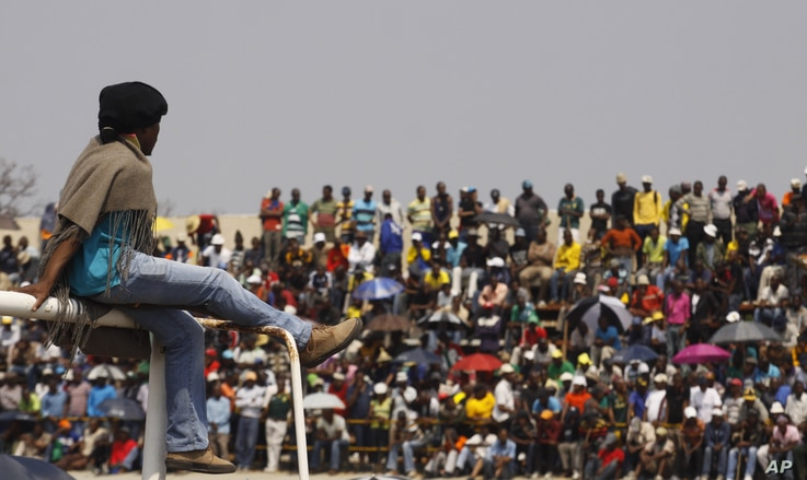 Striking workers at the Blesbok Stadium of the Anglo Platinum mine near Rustenburg,South Africa, September 13, 2012.