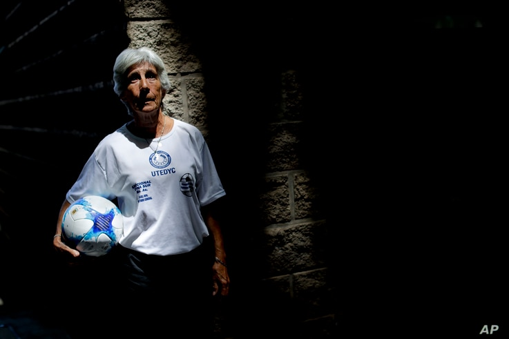 FILE - Elba Selva, a former player of Argentina national women's soccer team, poses for a photo in Buenos Aires, Argentina, Jan. 31, 2019. Selva represented Argentina during the Women's World Cup in 1971.