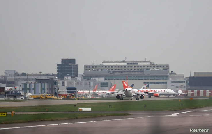 FILE - Aircraft taxi at Gatwick Airport in southern Britain, December 17, 2015.