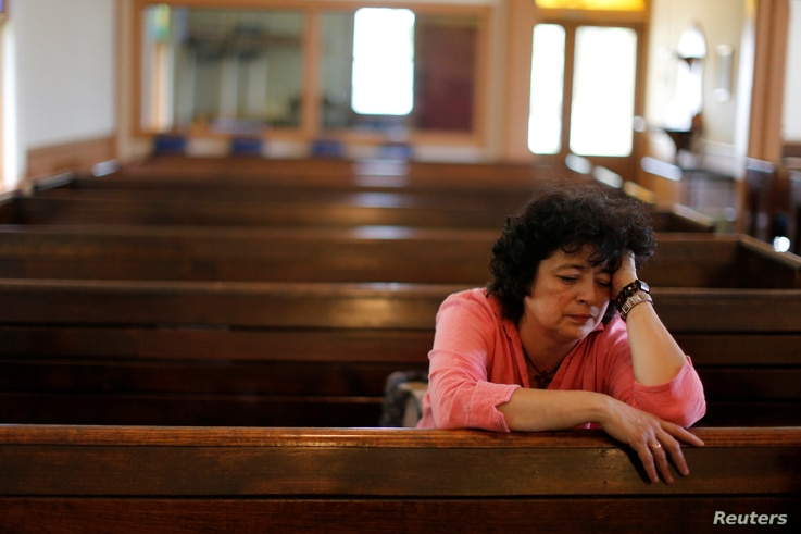 Immigrant Rosa Sabido sits in the United Methodist Church in which she lives while facing deportation in Mancos, Colorado, July 19, 2017.