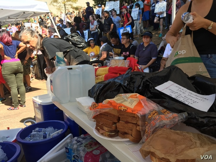 A volunteer made 100 peanut butter and jelly sandwiches for protesters who met at Marshall park in Charlotte, North Carolina, Sept. 24, 2016.