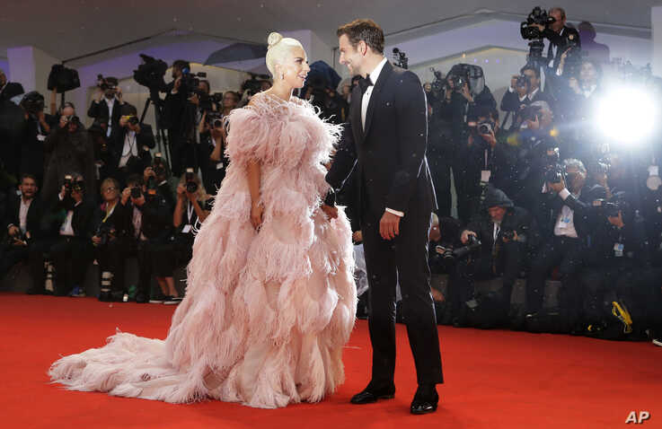 Actress and singer Lady Gaga, left, and actor Bradley Cooper pose for photographers upon arrival at the premiere of the film 'A Star Is Born' at the 75th edition of the Venice Film Festival in Venice, Italy.