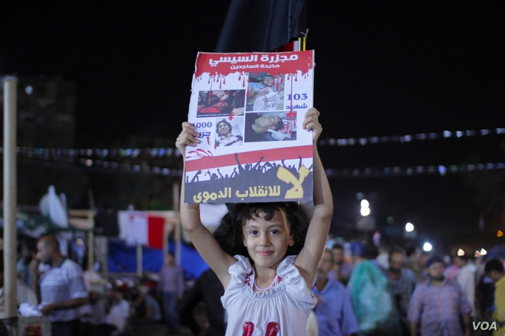 Pro-Morsi protesters say they are non-violent and unarmed, but they will still fight to protect the women and children living inside the camp. (Hamada Elrasam/VOA)