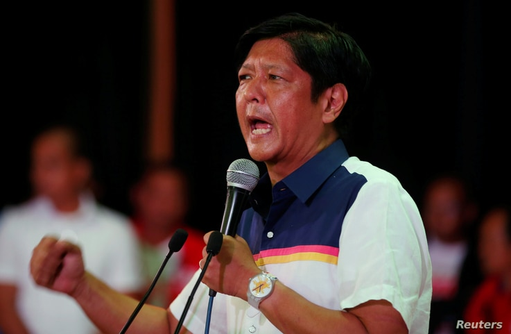 FILE - Philippines Vice Presidential candidate BongBong Marcos talks to supporters during an election campaign in the mountain resort of Baguio city in northern Philippines, April 16, 2016.